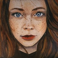 blue-eyed girl with freckles portrait