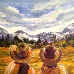 Cowboys looking at mountains